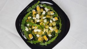 Dandelion leaves salad with potatoes and eggs.