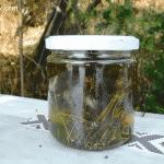 Marjorom infused oil in a jar.